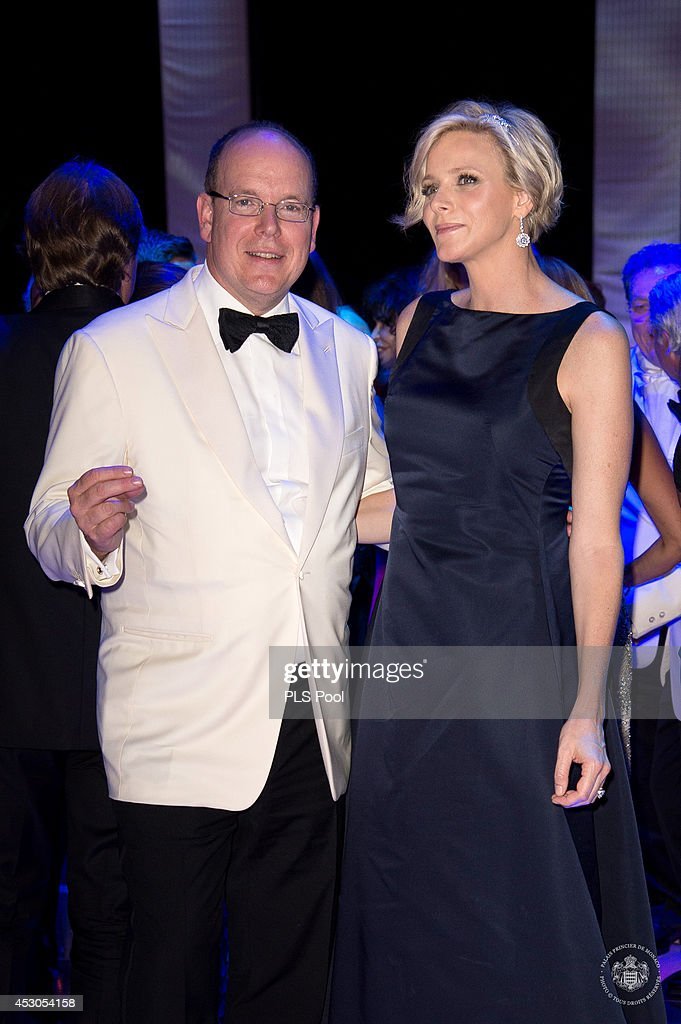 Prince Albert II of Monaco and Princess Charlene of Monaco dance during the 66th Monaco Red Cross Ball Gala at Sporting Monte-Carlo on August 1, 2014 in Monte-Carlo, Monaco.