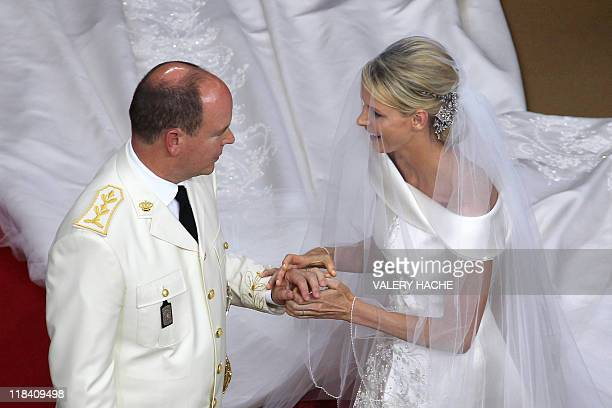 Prince Albert II of Monaco and Princess Charlene of Monaco exchange rings during their religious wedding at the Main Courtyard of the Prince's Palace...