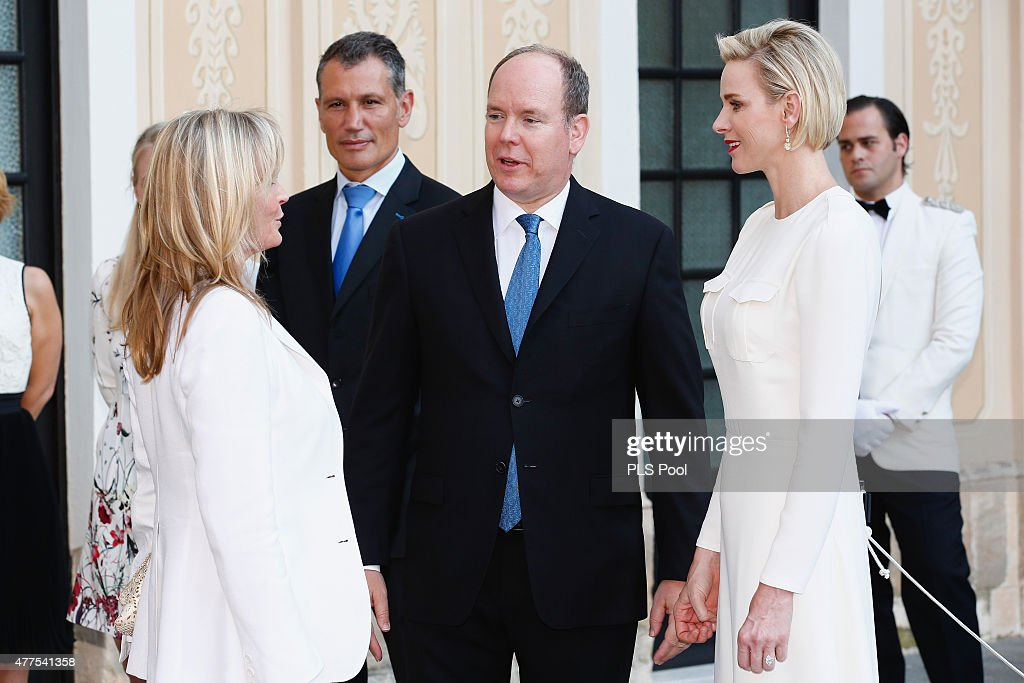 Prince Albert II of Monaco and Princess Charlene of Monaco greet actress Bo Derek during the Monaco Palace cocktail party of the 55th Monte Carlo TV festival on June 17, 2015 in Monte-Carlo, Monaco