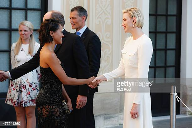 Prince Albert II of Monaco and Princess Charlene of Monaco greet actress Kat Graham during the Monaco Palace cocktail party of the 55th Monte Carlo...