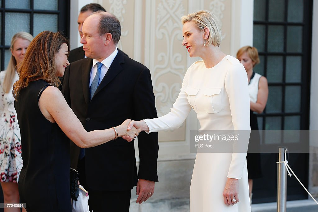 Prince Albert II of Monaco and Princess Charlene of Monaco greet guest during the Monaco Palace cocktail party of the 55th Monte Carlo TV festival on June 17, 2015 in Monte-Carlo, Monaco