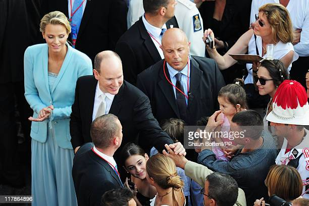 Prince Albert II of Monaco and Princess Charlene of Monaco greet well wishers after the civil ceremony of their Royal Wedding at the Prince's Palace...