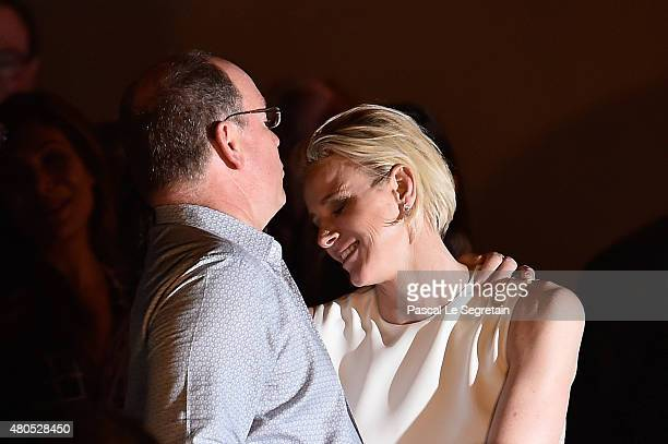 Prince Albert II of Monaco and Princess Charlene of Monaco hug each other during the Second Day of the 10th Anniversary on the Throne Celebrations on...