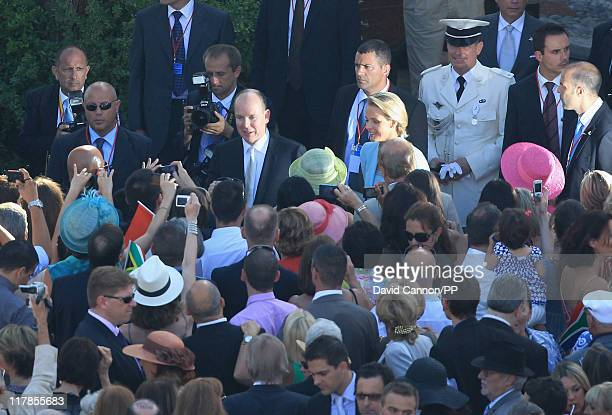 Prince Albert II of Monaco and Princess Charlene of Monaco join well wishers after the civil ceremony of their Royal Wedding at the Prince's Palace...