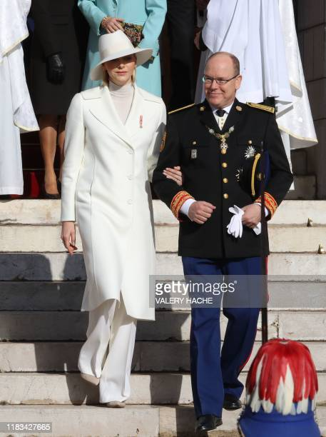 Prince Albert II of Monaco and Princess Charlene of Monaco leave after attending a mass at Monaco Cathedral during the celebrations marking Monaco's...