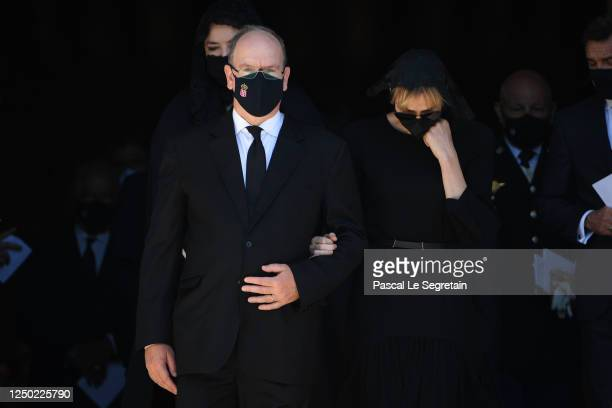 Prince Albert II of Monaco and Princess Charlene of Monaco leave the Monaco Cathedral after ElizabethAnn De Massy's Funerals on June 17 2020 in...