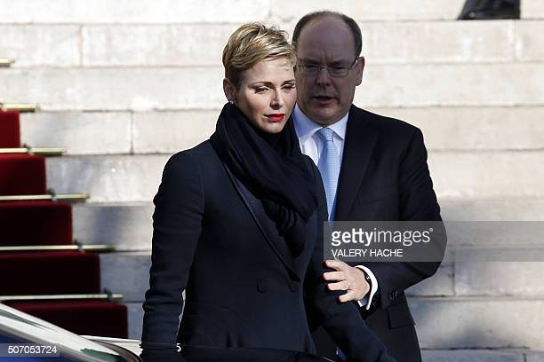 Prince Albert II of Monaco and Princess Charlene of Monaco leave the Monaco Cathedral during the SainteDevote festivities on January 27 2016 in...
