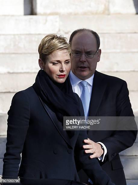 Prince Albert II of Monaco and Princess Charlene of Monaco leave the Monaco Cathedral during the SainteDevote festivities on January 27 2016 in...