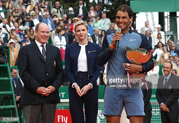 Prince Albert II of Monaco and Princess Charlene of Monaco look on as Rafael Nadal of Spain speaks to the crowd with the trophy after victory in the...