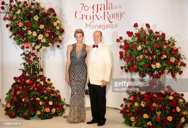 Prince Albert II of Monaco and Princess Charlene of Monaco pose as they arrive to attend the 70th annual Red Cross Gala at the MonteCarlo Sporting...