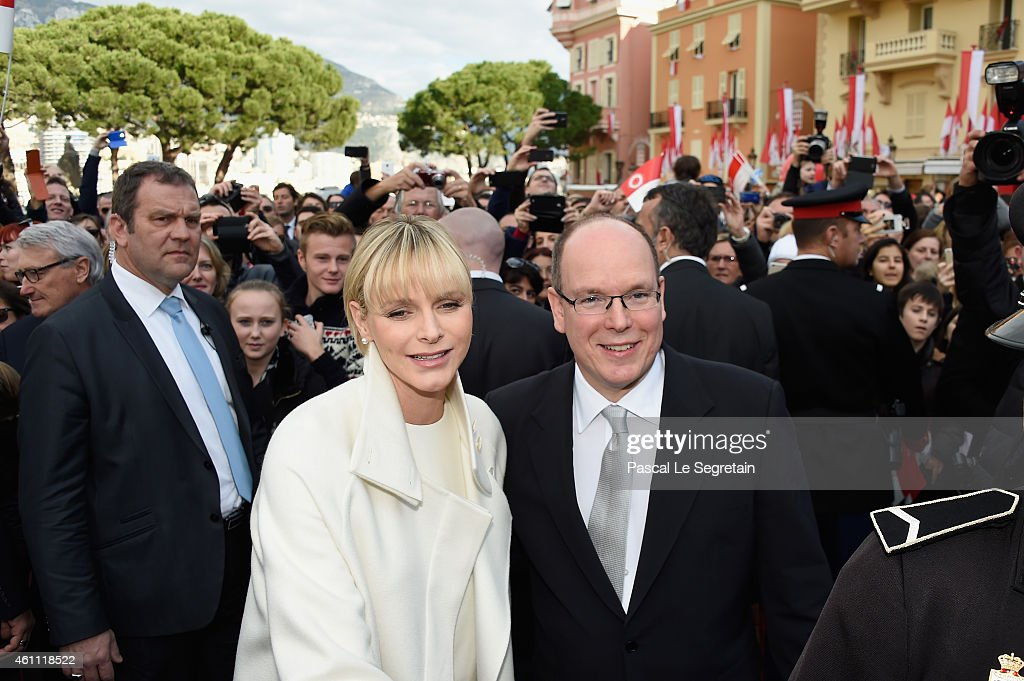 Prince Albert II of Monaco and Princess Charlene of Monaco pose as they gather with the crowd on January 7, 2015 in Monaco, Monaco.