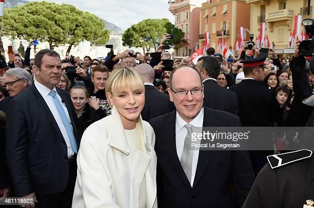Prince Albert II of Monaco and Princess Charlene of Monaco pose as they gather with the crowd on January 7 2015 in Monaco Monaco
