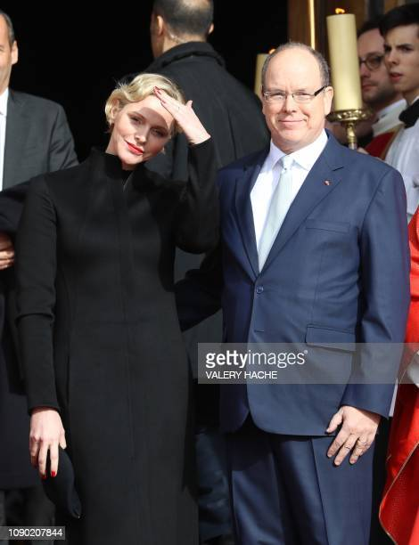 Prince Albert II of Monaco and Princess Charlene of Monaco pose for picture as they leave the Monaco Cathedral during Sainte Devote Celebrations in...