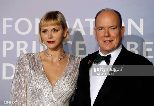 Prince Albert II of Monaco and Princess Charlene of Monaco pose on the red carpet ahead of the 2020 Monte-Carlo Gala for Planetary Health in Monaco...