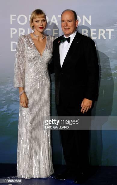 Prince Albert II of Monaco and Princess Charlene of Monaco pose on the red carpet ahead of the 2020 Monte-Carlo Gala for Planetary Health in Monaco...