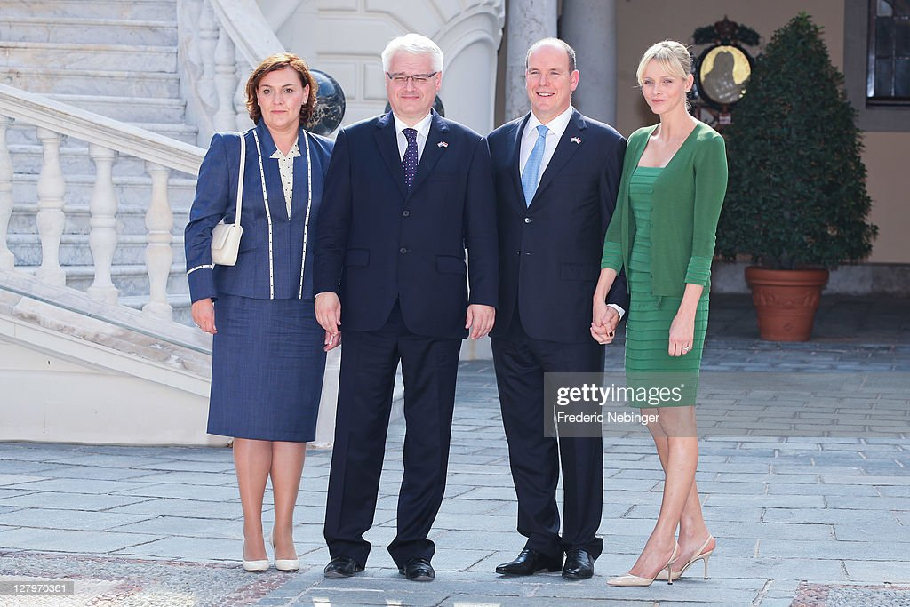 Prince Albert II of Monaco and Princess Charlene of Monaco pose with during the state visit of president Of Croatia Ivo Josipovic at Monaco Palace on October 4, 2011 in Monaco.