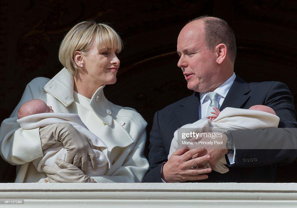 Prince Albert II of Monaco and Princess Charlene of Monaco pose with Prince Jacques and Princess Gabriella on the balcony of the Monaco Palace on January 7, 2015 in Monaco, Monaco.