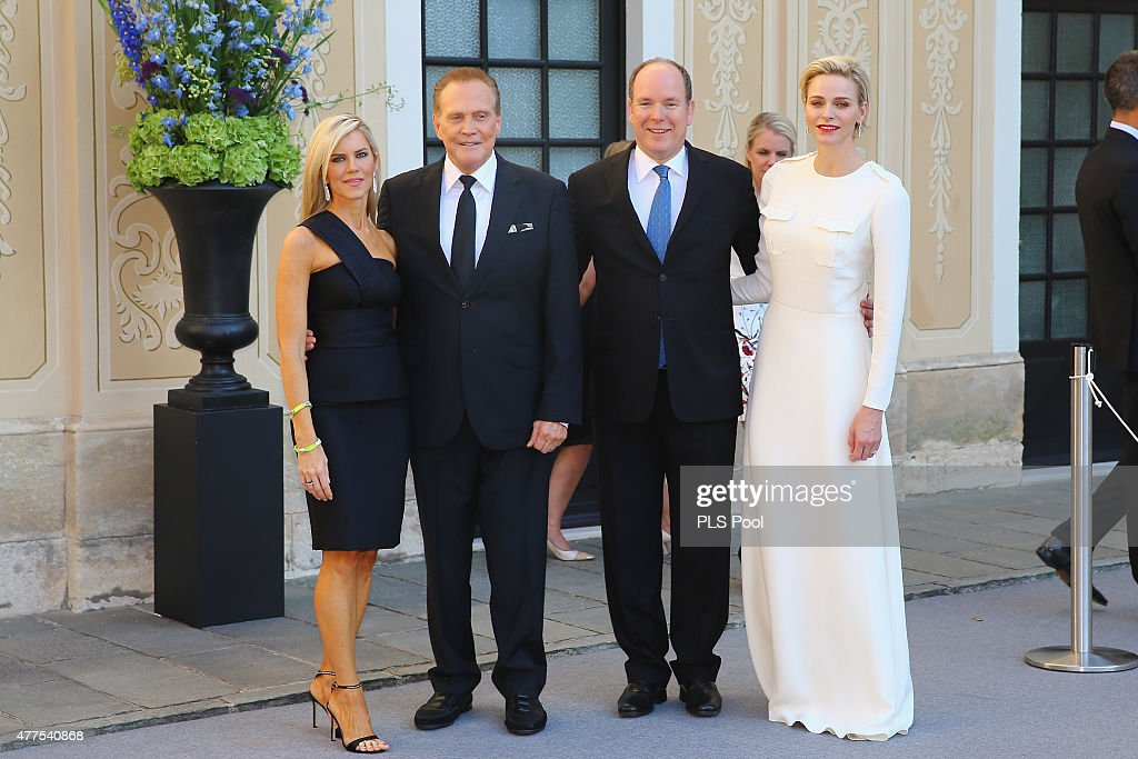 Prince Albert II of Monaco and Princess Charlene of Monaco pose with actor Lee Majors and wife during the Monaco Palace cocktail party of the 55th Monte Carlo TV festival on June 17, 2015 in Monte-Carlo, Monaco
