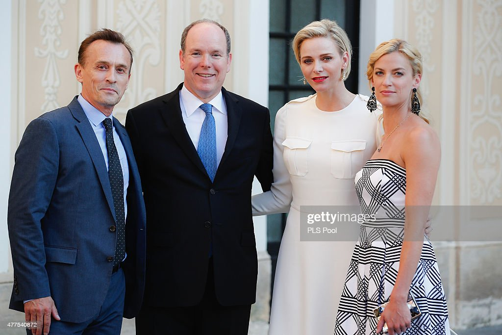 Prince Albert II of Monaco and Princess Charlene of Monaco pose with actor Robert Knepper and wife during the Monaco Palace cocktail party of the 55th Monte Carlo TV festival on June 17, 2015 in Monte-Carlo, Monaco