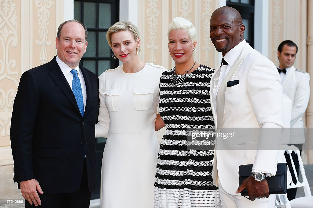 Prince Albert II of Monaco and Princess Charlene of Monaco pose with actor Terry Crews and wife during the Monaco Palace cocktail party of the 55th Monte Carlo TV festival on June 17, 2015 in Monte-Carlo, Monaco