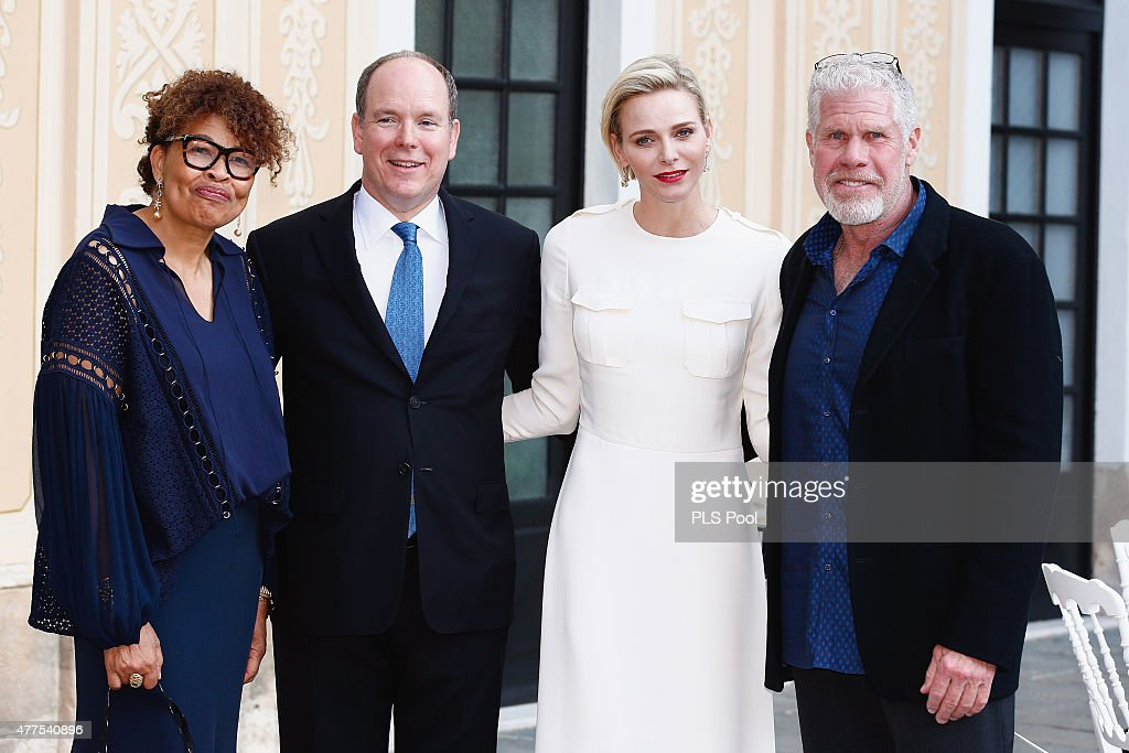 Prince Albert II of Monaco and Princess Charlene of Monaco pose with actor Ron Perlman and wife during the Monaco Palace cocktail party of the 55th Monte Carlo TV festival on June 17, 2015 in Monte-Carlo, Monaco