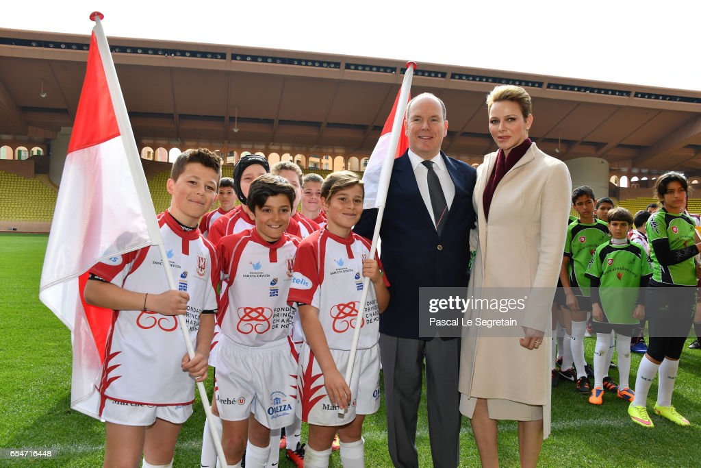 Prince Albert II of Monaco and Princess Charlene of Monaco pose with the Under-12 Rugby team of Monaco prior the Sainte Devote Rugby Tournament on March 18, 2017 in Monte-Carlo, Monaco.