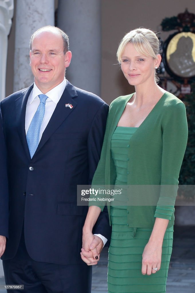 SAS Prince Albert II of Monaco and Princess Charlene of Monaco posing for pictures during the state visit of president Of Croatia Ivo Josipovic At Monaco Palace at Monaco Palace on October 4, 2011 in Monaco, Monaco.
