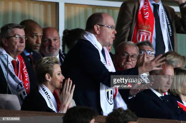 Prince Albert II of Monaco and Princess Charlene of Monaco react after the second goal of Juventus while Thierry Henry looks on during the UEFA...