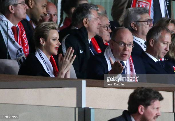 Prince Albert II of Monaco and Princess Charlene of Monaco react after the second goal of Juventus during the UEFA Champions League semi final first...