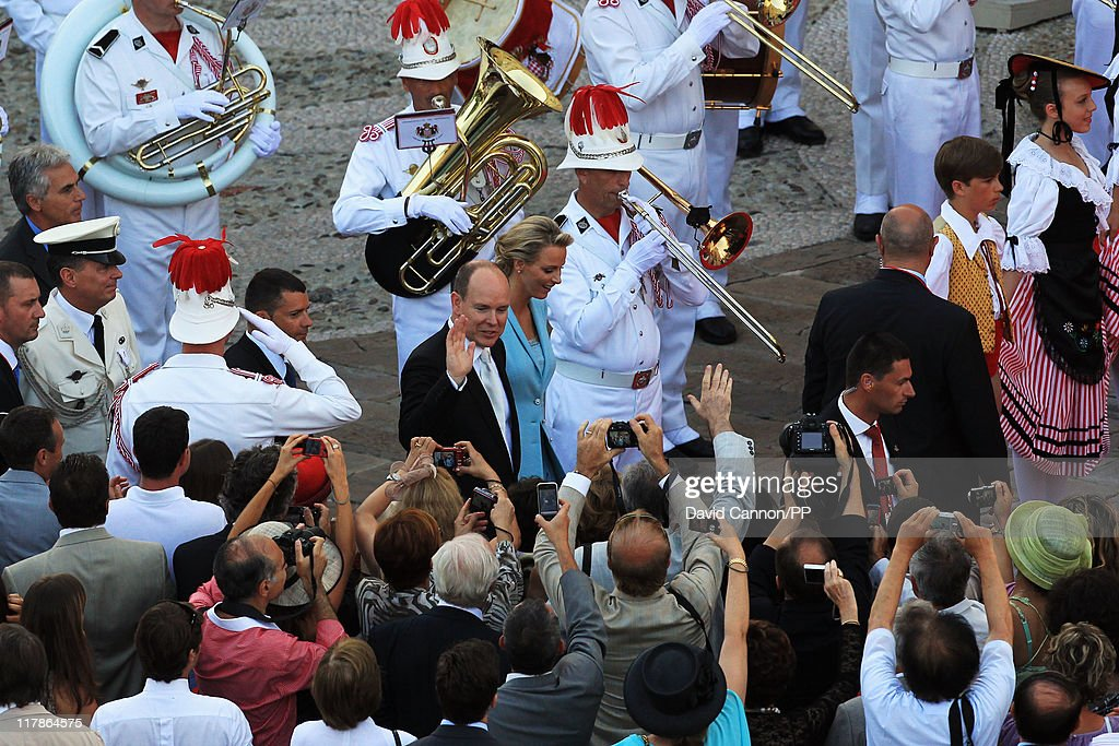 Prince Albert II of Monaco and Princess Charlene of Monaco wave at well wishers after the civil ceremony of their Royal Wedding at the Prince's Palace on July 1, 2011 in Monaco. The ceremony took place in the Throne Room of the Prince's Palace of Monaco, followed by a religious ceremony to be conducted in the main courtyard of the Palace on July 2. With her marriage to the head of state of Principality of Monaco, Charlene Wittstock has become Princess consort of Monaco and gain the title, Princess Charlene of Monaco. Celebrations including concerts and firework displays are being held across several days, attended by a guest list of global celebrities and heads of state.