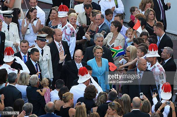 Prince Albert II of Monaco and Princess Charlene of Monaco wave at well wishers after the civil ceremony of their Royal Wedding at the Prince's...