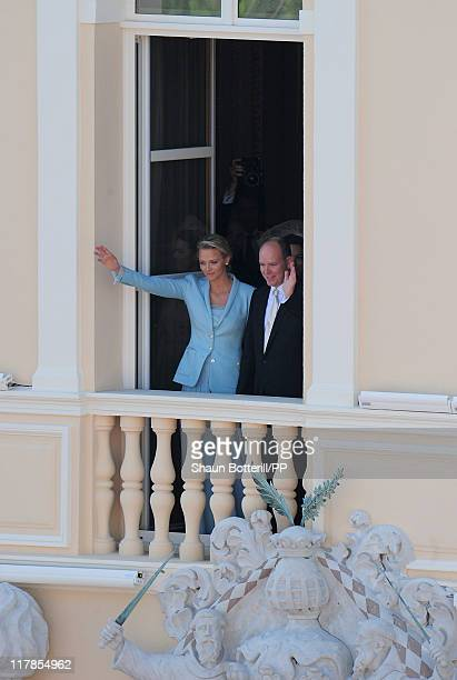 Prince Albert II of Monaco and Princess Charlene of Monaco wave from the balcony to well wishers after the civil ceremony of their Royal Wedding at...