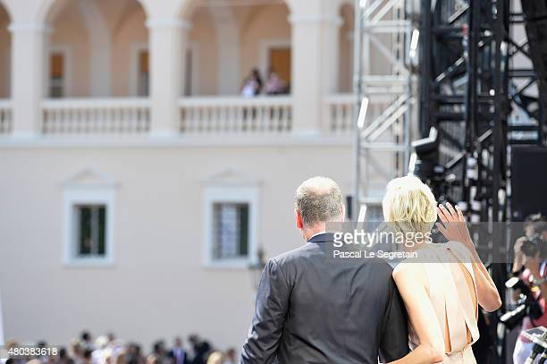 Prince Albert II of Monaco and Princess Charlene of Monaco wave to their children during the First Day of the 10th Anniversary on the Throne...