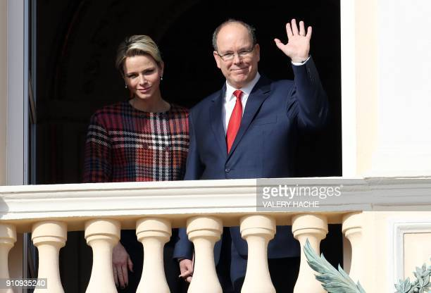Prince Albert II of Monaco and Princess Charlene of Monaco wave to the crowd as they appear on the palace's balcony during Sainte Devote Celebrations...
