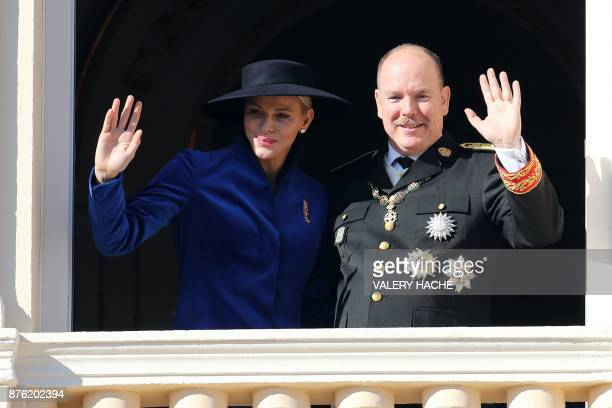 Prince Albert II of monaco and Princess Charlene of Monaco waves to the public from the balcony of the Monaco Palace during the celebrations marking...