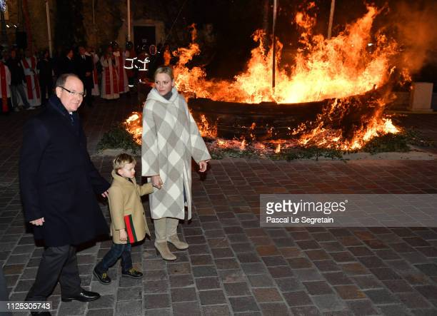 Prince Albert II of Monaco and Princess Charlene of Monaco with Prince Jacques of Monaco attend the Ceremony Of The SainteDevote In Monaco on January...