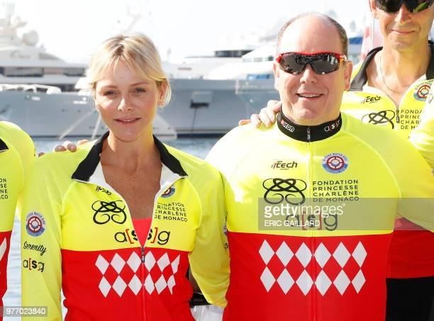 Prince Albert II of Monaco and Princess Charlene pose before the start of the Riviera Water Bike Challenge in support of the Princess Charlene...