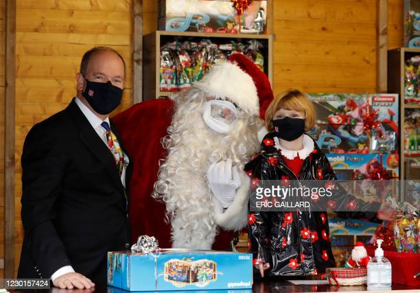 Prince Albert II of Monaco and Princess Gabriella, wearing protective face masks, attend the traditional Christmas tree ceremony as part of the...