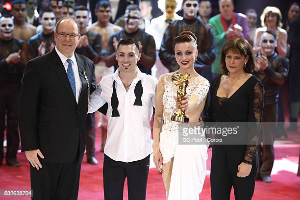 Prince Albert II of Monaco and Princess Stephanie of Monaco pose with artists Sky Angels winner of a Golden Clown award at the awards ceremony of the...