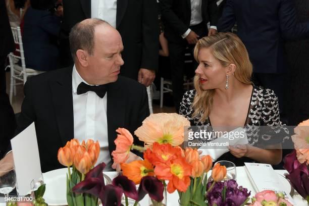 Prince Albert II of Monaco and Sienna Miller attend FIA Formula E Gala Dinner at Villa Miani on April 14, 2018 in Rome, Italy.