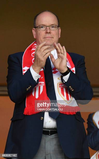 Prince Albert II of Monaco applauds as he celebrates Monaco's victory at the end of the French L1 football match between AS Monaco and LOSC Lille at...
