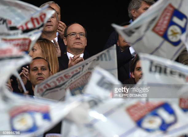 Prince Albert II of Monaco attends the French L1 football match Olympique Lyonnais and AS Monaco on May 7 at the New Stadium in DecinesCharpieu near...