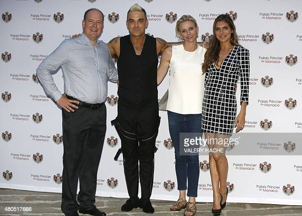 Prince Albert II of Monaco British singer Robbie Williams Princess Charlene of Monaco and Williams' wife Ayda Field pose prior to Robbie Williams'...