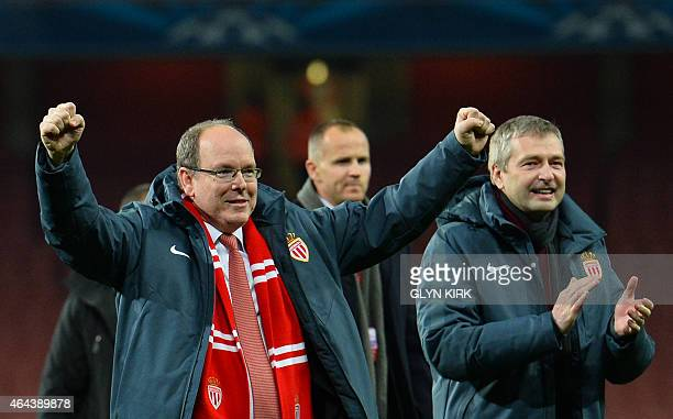 Prince Albert II of Monaco celebrates on the field with Monaco's Russian president Dmitry Rybolovlev after the final whistle of the UEFA Champions...