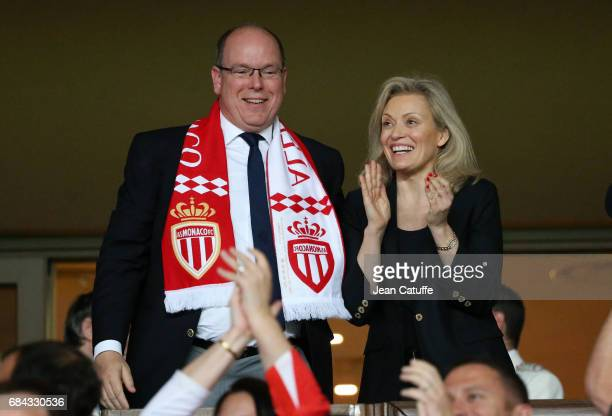 Prince Albert II of Monaco celebrates with President of French League Nathalie Boy de la Tour winning the French Ligue 1 Championship title following...