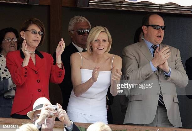Prince Albert II of Monaco Charlene Wittstock and Princess ElisabethAnne De Massy applaud at the end of the Monte Carlo ATP Masters Series tournament...