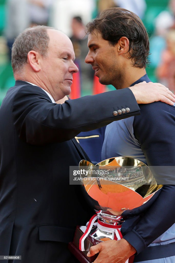 Prince Albert II of Monaco congratulates winner Spain's Rafael Nadal during the awarding ceremony following the final tennis match at the Monte-Carlo ATP Masters Series Tournament in Monaco on April 17, 2016. Nadal defeated Monfils 7-5, 5-7, 6-0 to win a record ninth title at the Monte Carlo Masters.