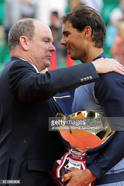 Prince Albert II of Monaco congratulates winner Spain's Rafael Nadal during the awarding ceremony following the final tennis match at the MonteCarlo...