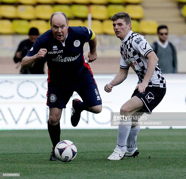 Prince Albert II of Monaco controls the ball during a charity football match between Prince Albert's Star Team and the F1 'Nazionale Piloti' drivers'...