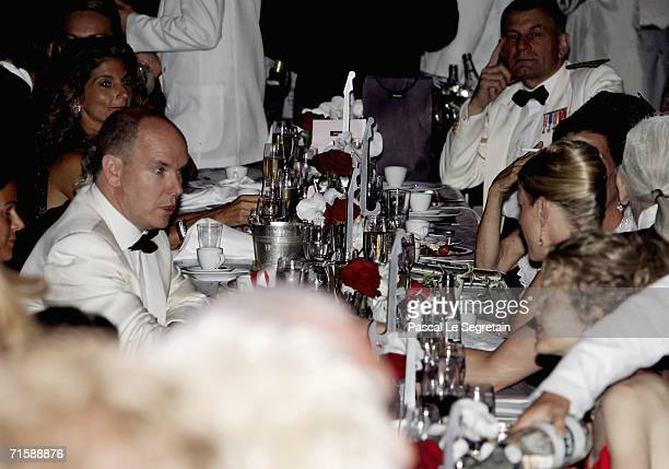 Prince Albert II of Monaco converse with Charlene Wittstock as they attend the Monaco Red Cross Ball dinner under the Presidency of HSH Prince Albert...
